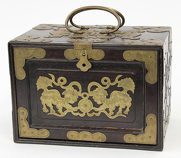 Note the stylized lions on the front of this beautiful wood box with brass trimming